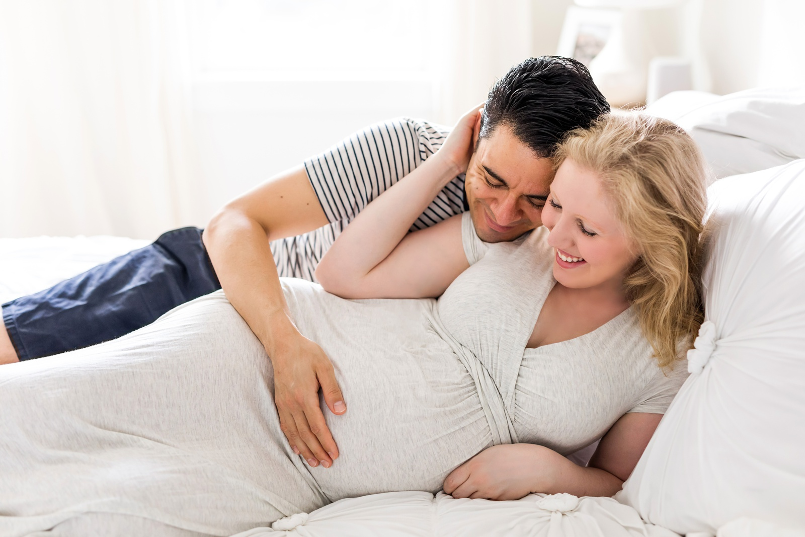 Soon-to-be parents lying in bed